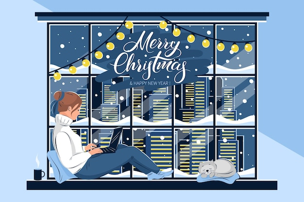 Frau im pullover und mit laptop sitzt am winterfenster die katze schläft daneben