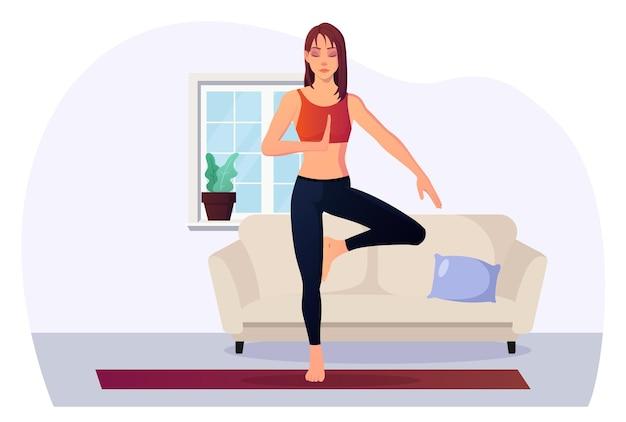 Frau in baumhaltung praktiziert yoga indoor für gesundheit und entspannung