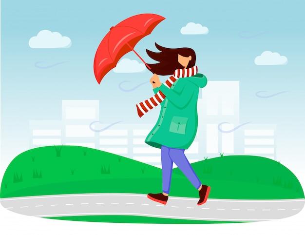 Frau in der flachen farbillustration des regenmantels. windiges wetter. regnerischer tag. frau mit regenschirm. gehende kaukasische dame im schal gesichtslose karikaturfiguren mit gras und himmel auf hintergrund