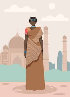 Frau in der indischen sari auf taj mahal background.