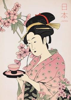 Frau in einem kimono, der eine teetasse hält. traditioneller japanischer stil. geisha-kostüm.