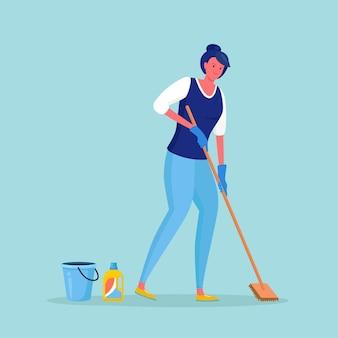 Frau in handschuhen, die boden mit mopp waschen