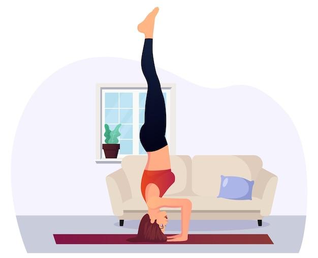 Frau in handstandposition, die zu hause yoga für fitness und entspannung durchführt premium-vektor