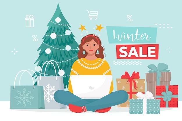 Frau in weihnachtskleidung kauft waren im online-shop von zu hause aus vektorillustration im flachen stil
