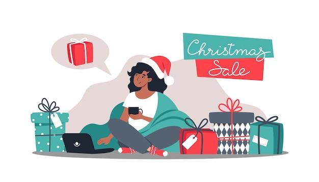 Frau kauft geschenke im online-shop, neujahr und weihnachten online-shopping von zu hause aus