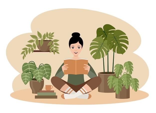 Frau liest ein buch mit pflanzen