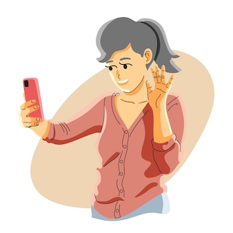 Frau macht einen videoanruf von ihrem telefon
