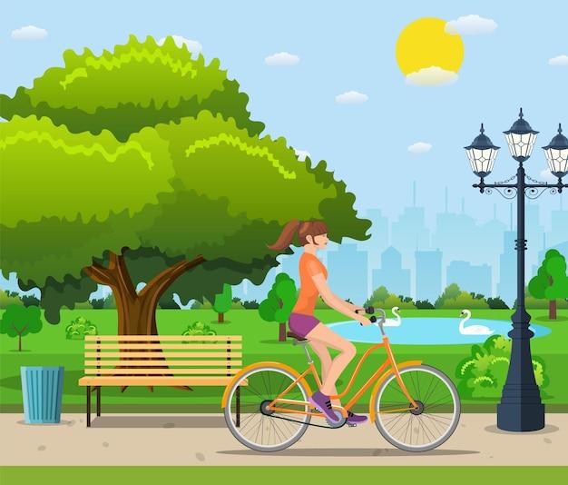 Frau mit dem fahrrad im öffentlichen park