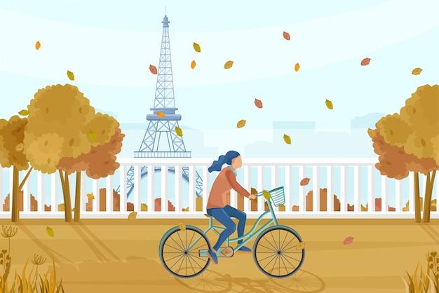 Frau mit dem fahrrad in paris