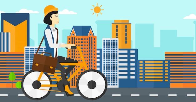 Frau mit dem fahrrad zur arbeit