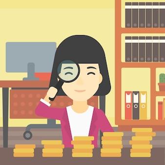 Frau mit dem vergrößerungsglas, das goldene münzen betrachtet.