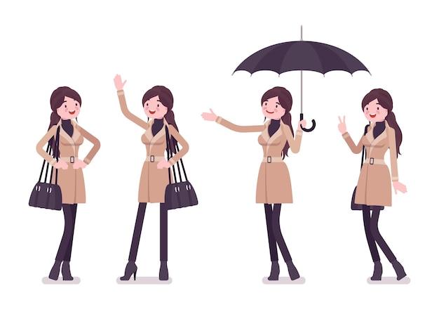 Frau mit den positiven emotionen des regenschirms, die herbstkleidungsillustration tragen