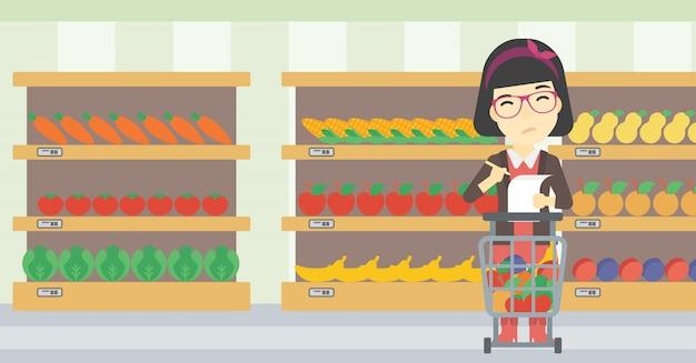 Frau mit einkaufsliste.
