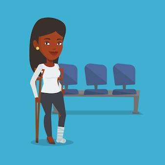 Frau mit gebrochenem bein und krücken.