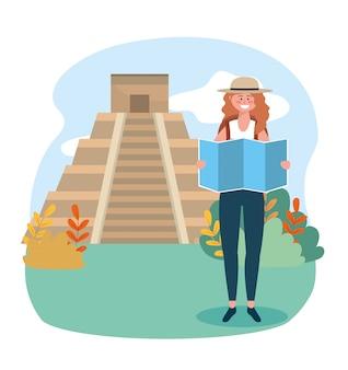 Frau mit hut mit globaler karte und tempel inschrift