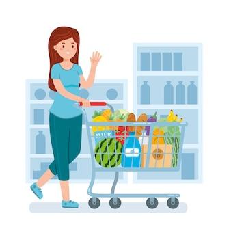 Frau mit produkten im lebensmittelgeschäft