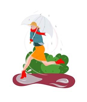 Frau mit regenschirm, die bei windigem regnerischem kaltem wetter läuft