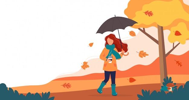 Frau mit regenschirm und kaffee im herbst.