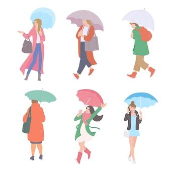 Frau mit regenschirmen im regen in verschiedenen herbst-freizeitkleidung des städtischen stils. flacher stil.