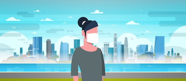 Frau mit schutzmaske gegen verschmutzung
