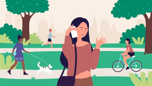 Frau mit telefon im stadtpark