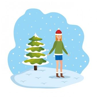 Frau mit weihnachtsstrickjacke und -hut im snowscape