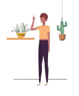Frau mit zimmerpflanze- und makrameeaufhängern