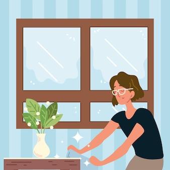 Frau putzt mit tuch