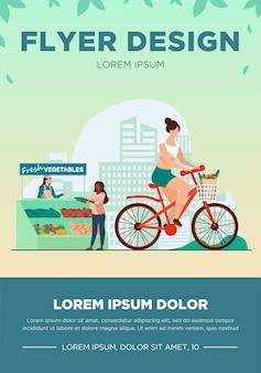 Frau radfahren und frisches gemüse kaufen. lebensstil, fahrrad, markt flache vektorillustration. gesundes essen und aktivitätskonzept