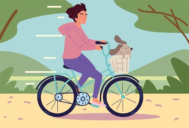 Frau reitet fahrrad mit haustier