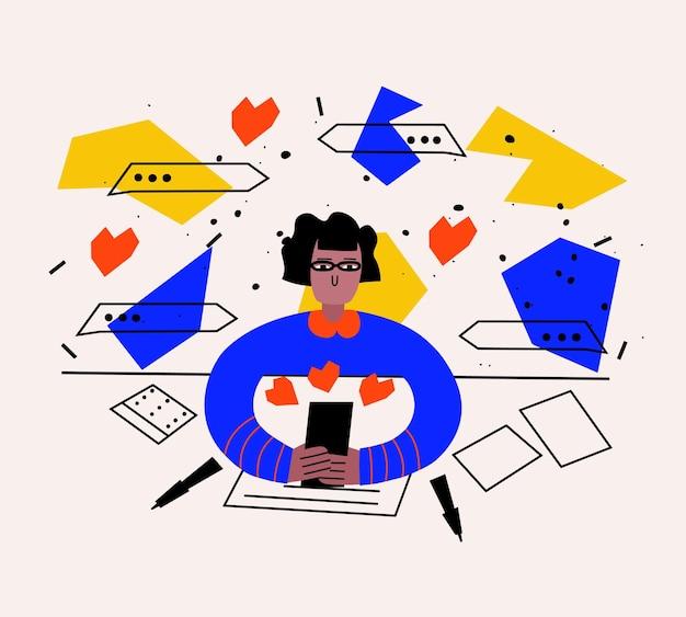 Frau schreibt am tisch eine sms