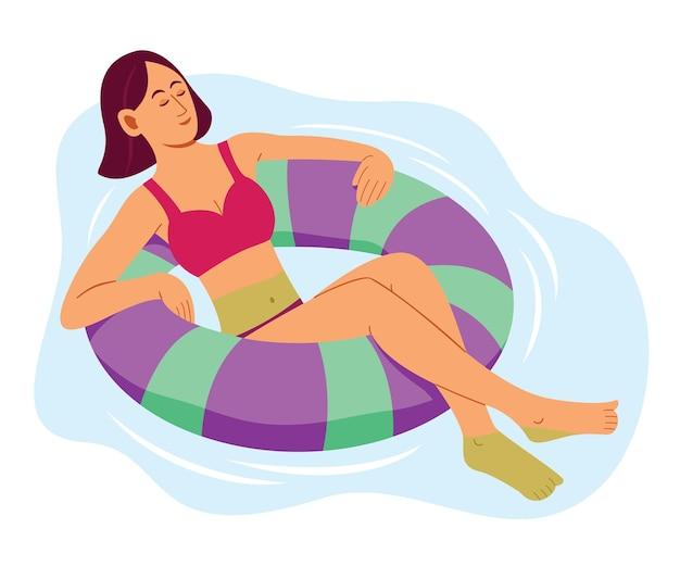 Frau schwimmt auf dem aufblasbaren schwimmring im schwimmbad
