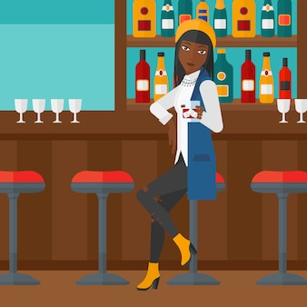 Frau sitzt an der bar