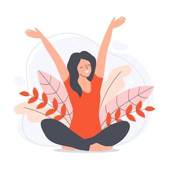Frau sitzt im lotussitz mit ihren armen in der luft glückliches junges mädchen im natürlichen hintergrund
