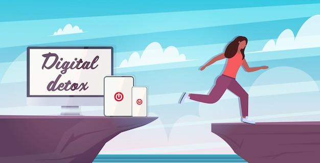 Frau springt über klippenabgrund, der vom digitalen entgiftungskonzept der geräte wegläuft