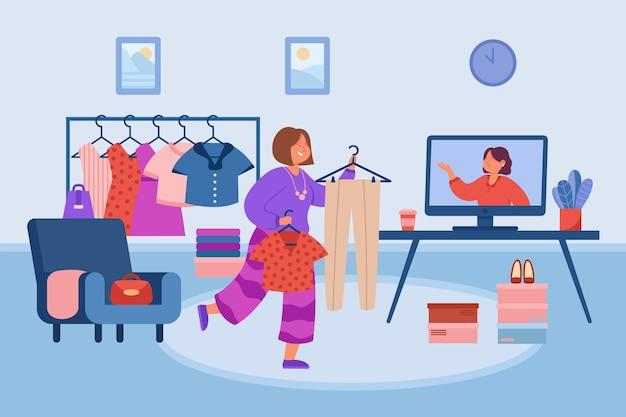Frau überprüft ihre garderobe vor dem computer
