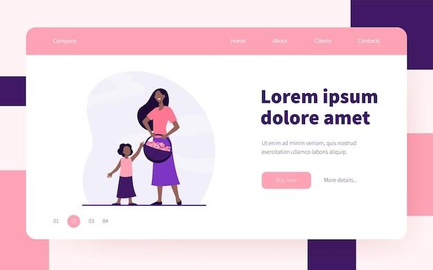 Frau und kind tragen erdbeerkorb