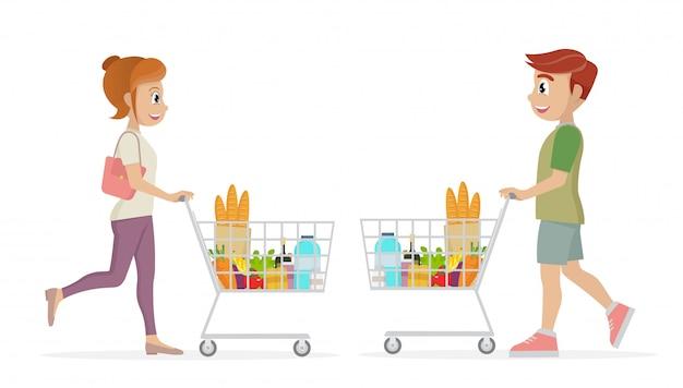Frau und mann, die einen einkaufswagen voll von lebensmittelgeschäften im supermarkt tragen.