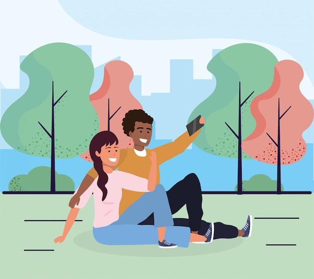 Frau und mann, die zusammen mit smartphone setzen