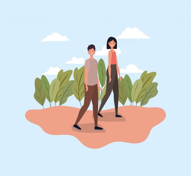 Frau und mann gehen am park