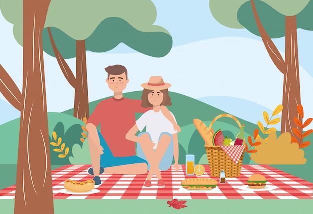 Frau und mann in der tischdecke mit brot- und weinflasche