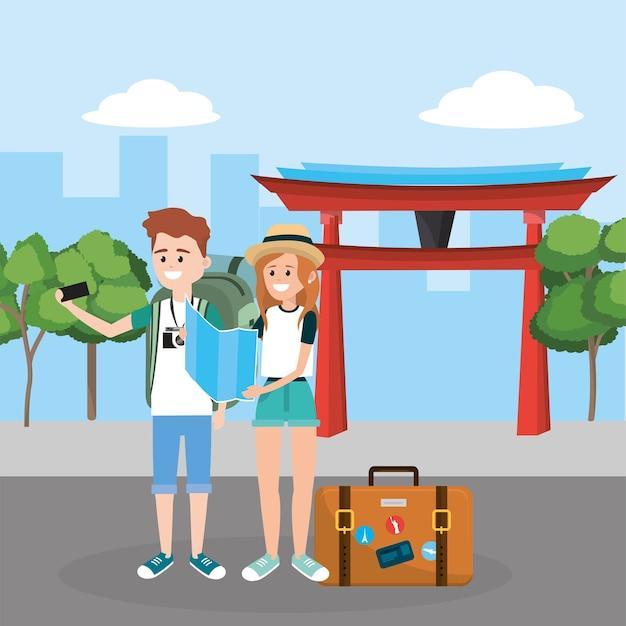 Frau und mann mit smarphone im chinesischen tempel