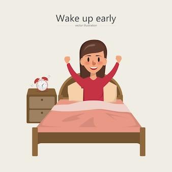 Frau wacht morgens im schlafzimmer auf