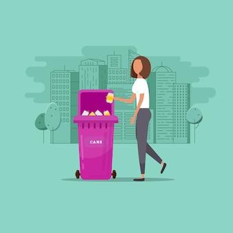 Frau wirft müll in einen organischen behälter