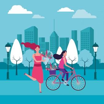 Frauen, die fahrrad mit blume reiten