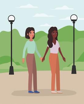Frauen, die hände am park halten