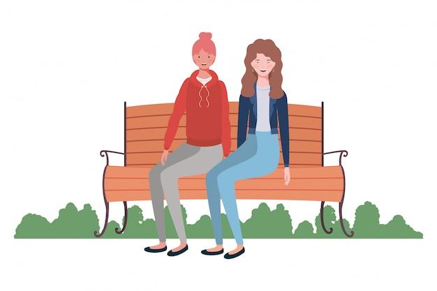 Frauen, die im parkstuhl mit landschaft sitzen