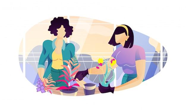 Frauen, die inländische blumen am gewächshaus wieder pflanzen