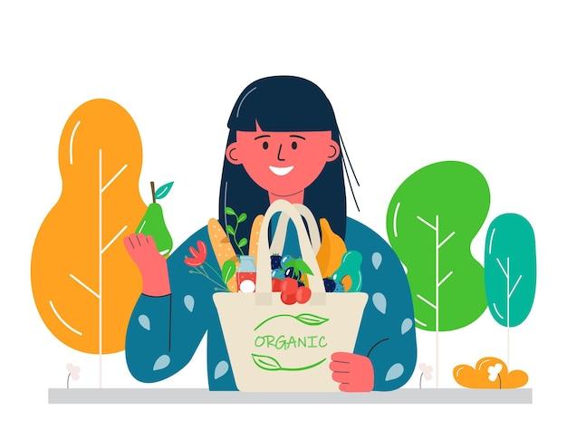 Frauen, die öko-einkaufstaschen mit gemüse, obst und gesunden getränken halten. milchprodukte im wiederverwendbaren umweltfreundlichen einkaufsnetz