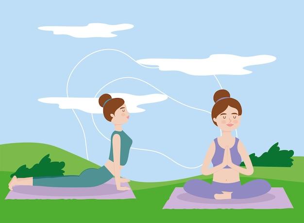 Frauen, die yoga praktizieren und im freien meditieren
